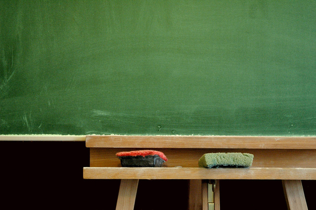 School chalk board with chalk and eraser