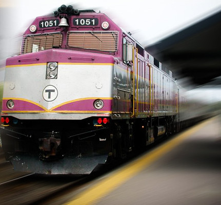 commuter rail train pulls into station