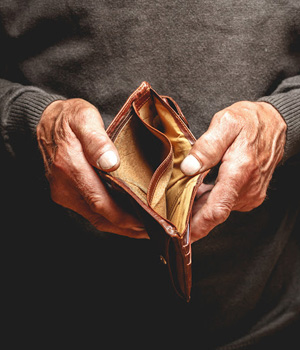 A man holds open an empty wallet