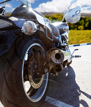 a motorcycle gleams in the sun
