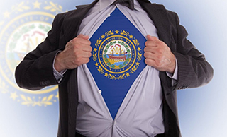 man wearing the nh state seal on his shirt