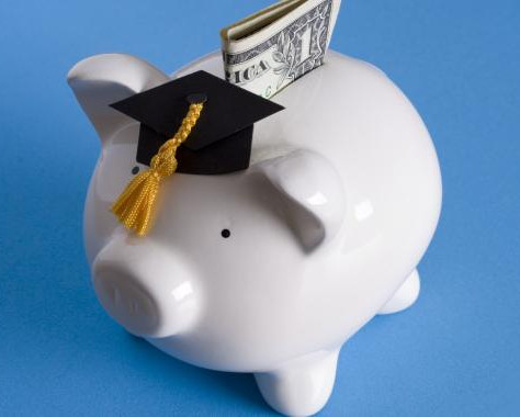 A piggy bank wearing a graduate's cap