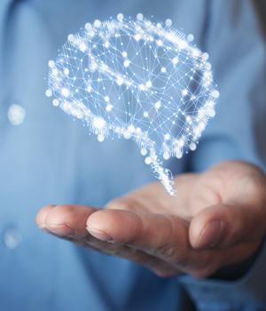 man holds a digital brain