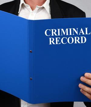"Man holding a folder that says ""criminal record"""