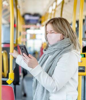 girl on bus wearing mask