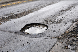 funding for local road infrastructure repairs