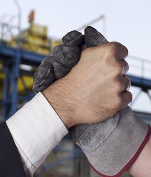 union worker and business owner arm wrestle