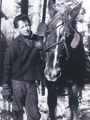 Tom Thomson on family tree farm with work horse Babe